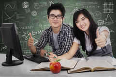 Cheerful students showing tumbs-up Stock Photo