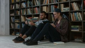 Clever bookworms students in the library studying stock video