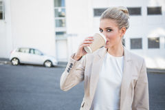 Cheerful stylish businesswoman drinking coffee Stock Photo