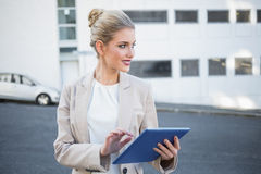 Cheerful stylish businesswoman using digital tablet Stock Images
