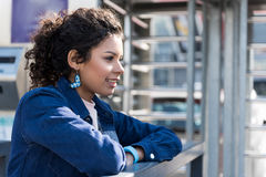 Cheerful stylish teen mulatto spending time in city royalty free stock photo