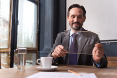 Cheerful successful businessman holding a the tablet Stock Images