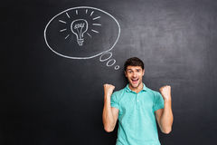 Cheerful successful young man having an idea and celebrating success Royalty Free Stock Image