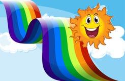 A cheerful sun near the rainbow Royalty Free Stock Photography