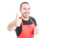 Cheerful supermarket employee showing double like sign Royalty Free Stock Photos