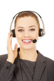 Cheerful support phone operator in headset. Stock Image