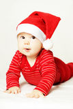 Cheerful surprised baby in red Santa hat Stock Photography