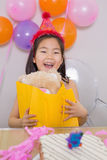 Cheerful surprised little girl at her birthday party Royalty Free Stock Images