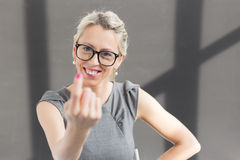 Cheerful teacher inviting students to her class Stock Images