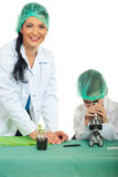 Cheerful teacher with student in laboratory Royalty Free Stock Photo