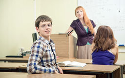 Cheerful teacher with students Royalty Free Stock Photos