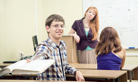 Cheerful teacher with students Stock Photo