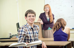 Cheerful teacher with students Royalty Free Stock Image