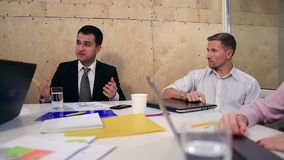Cheerful team of business people in meeting room stock footage