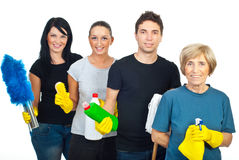 Cheerful team of cleaning people. Cheerful team of four people holding cleaning products isolated on white background stock photography
