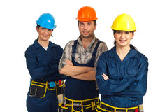 Cheerful team of three constructor workers Royalty Free Stock Photos