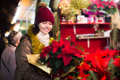 Cheerful teen girl chooses floral decorations Royalty Free Stock Photos