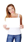 Cheerful teen girl holding blank white paper Stock Images