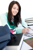 Cheerful teen girl studying on a desk Stock Photo