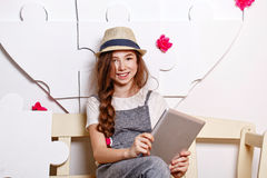 Cheerful teen girl with a tablet Royalty Free Stock Photo