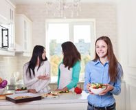 Cheerful teen girls preparing salad together Royalty Free Stock Photography