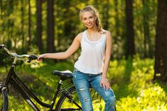 Cheerful teenage on a bicycle outdoors Royalty Free Stock Photography
