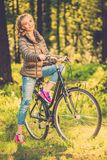 Cheerful teenage on a bicycle outdoors Royalty Free Stock Image