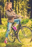 Cheerful teenage on a bicycle outdoors Royalty Free Stock Images