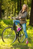 Cheerful teenage on a bicycle outdoors Stock Photo
