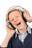 Cheerful teenage boy enjoy music from headphones Stock Image