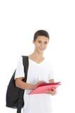 Cheerful teenage boy writing in file Stock Photo