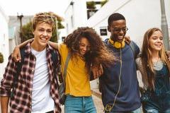 Free Cheerful Teenage Friends Enjoying Outdoors Stock Photo - 155141380