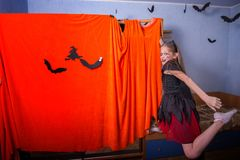 Cheerful teenage girl in a costume for Halloween Royalty Free Stock Photos