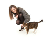 Cheerful teenage girl with her lovely cat Royalty Free Stock Images