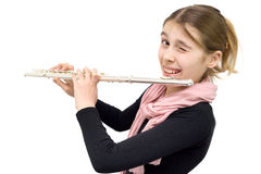 Cheerful Teenage Girl Holding Flute and Winking into the Camera Isolated on White. Side View of Young Flute Player Playing Flute Winking and Smiling into the Stock Images