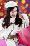 Cheerful teenage girl looking shopping bags Royalty Free Stock Photo