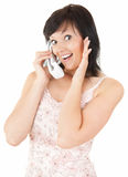 Cheerful teenage girl speaking on the phone. White background Stock Photo