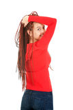 Cheerful teenage girl in tresses looking at camera Stock Photography
