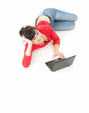 Cheerful teenage girl using laptop, full length Stock Image