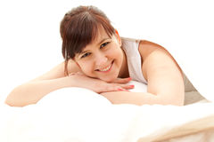 Cheerful teenage girl in white bedding Royalty Free Stock Photography