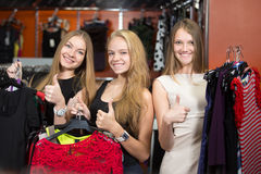 Cheerful teenage girls satisfied with shopping Stock Photography