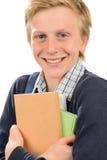 Cheerful teenage student holding books Royalty Free Stock Photo