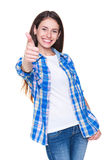 Cheerful teenager. Showing thumbs up and smiling. isolated on white background royalty free stock photography