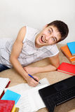 Cheerful Teenager doing Homework Royalty Free Stock Image