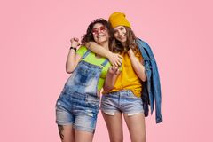 Cheerful teenager hugging best friend royalty free stock images