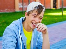 Cheerful Teenager outdoor. Cheerful Teenager sit on the City Street stock images