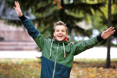 Cheerful teenager in park. On autumn day royalty free stock photo