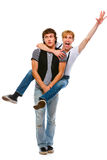 Cheerful teenager piggy backing his friend. On white Stock Photos