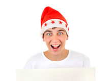 Cheerful Teenager in Santa Hat Stock Images