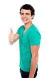Cheerful teenager showing thumbs up to camera Royalty Free Stock Photos